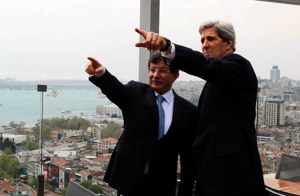 Turkish Foreign Minister Ahmet Davutoglu shows U.S. Secretary of State John F. Kerry the skyline of Istanbul before the start of a meeting in the Turkish city.