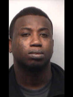 "The Atlanta rapper and actor Gucci Mane was booked into the Fulton County Jail on March 27, 2013, after he turned himself in on suspicion of aggravated assault with a weapon, according to the Atlanta Journal Constitution. <br><br> The Fulton County Sheriff's Department said Gucci Mane (born Radric Davis) allegedly hit a man over the head with a Champagne bottle at a night club after the man asked to take a photo with him. According to ABC News,  the man is a soldier. <br><br> <strong>Full story:</strong> <a href=""http://www.latimes.com/entertainment/music/posts/la-et-ms-gucci-mane-assault-charge-20130327,0,1666877.story"">Gucci Mane jailed on assault charge</a>"