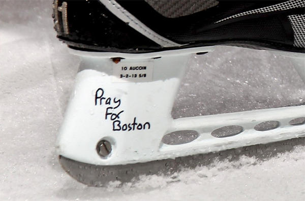 "New York Islanders' Keith Aucoin skates during warmups with the words ""Pray for Boston"" written on his skates."