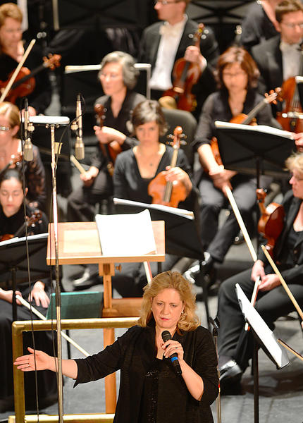 Elizabeth Schulze, music director and conductor of the Maryland Symphony orchestra speaks about the musical selections performed during the last concert of the 2012-2013 season, Orchestral Dances on Sunday at the Maryland Theater in Hagerstown.