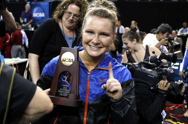 Florida's Bridget Sloan gives the No. 1 sign after winning all-around gymnast at the NCAA championships on Sunday at Pauley Pavilion.