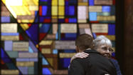 BOSTON (AP) — As churches paused to mourn the dead and console the survivors of the Boston Marathon bombing Sunday, the city's police commissioner said the two suspects had such a large cache of weapons that they were probably planning other attacks. The surviving suspect remained hospitalized and unable to speak with a gunshot wound to the throat.