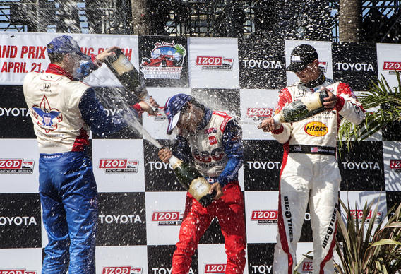 From left, Justin Wilson, Takuma Sato, and Graham Rahal celebrate on the podium after the IndyCar Series Grand Prix of Long Beach auto race.