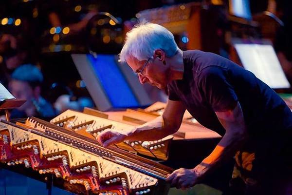 "Dean Drummond plays a kithara instrument, built by Harry Partch, during a 2007 performance of Partch's ""Delusion of the Fury."""
