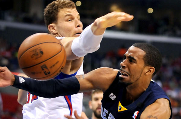 Clippers power forward Mike Conley is forced to pass after driving into the defense of Clippers power forward Blake Griffin on Saturday night.