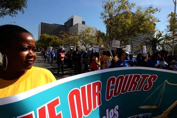 Union member Kristian Huling attends a March protest in downtown Los Angeles. Demonstrators were opposing cuts that would close eight county courthouses.