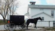 KALONA, Iowa — A white van, its sides covered with the words Kalona By-Ways Tours, sits parked in front of an Amish country store, a steady stream of plainly dressed men and women coming and going.
