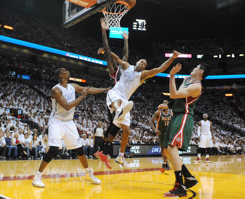 Shane Battier of the Miami Heat takes a fould from the Milwaukee Bucks Larry Sanders  during the second period, Sunday, April 21, 2013, of a first round playoff game,  at the AmericanAirlines Arena in Miami.Joe Cavaretta, SunSentinel (c)2013..