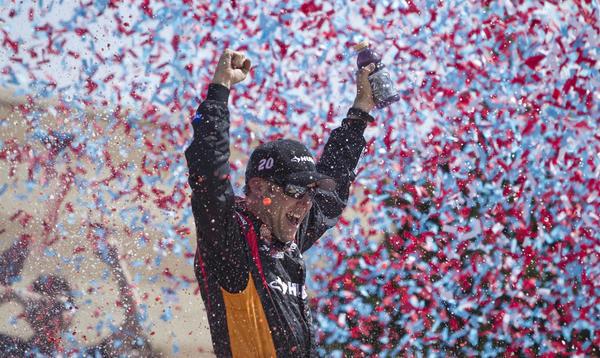 Matt Kenseth celebrates winning the NASCAR Sprint Cup series race at Kansas Speedway on Sunday.