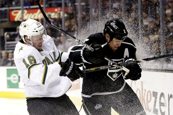 Dallas Stars' Reilly Smith, left, collides with Kings' Matt Greene during the first period.