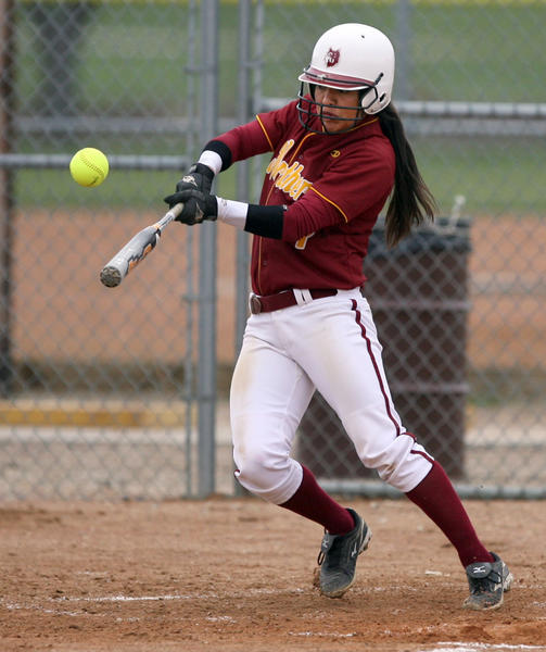 Northern States Caitlin Moran lays down a bunt this season in a game against Minnesota-Duluth in a doubleheader played on the artificial turf at Swisher Field in Aberdeen. Those are the only home softball games so far this season. American News Photo by John Davis