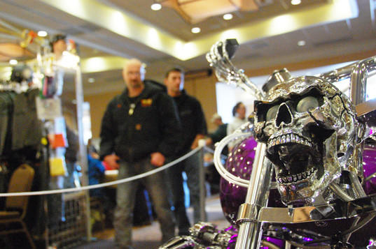 Dan Bawek, left, and Dexter Wipf stroll the floor at the annual Bike Show and Dance at the Dakota Event Center on Sunday in Aberdeen. The show featured more than 70 motorcycles from area motorcycle shops and drew more than 1,000 visitors, according to event coordinators.