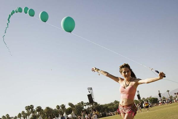 As part of the art offerings at this year's Coachella Music and Arts Festival concert-goers could pose with a long balloon chain..
