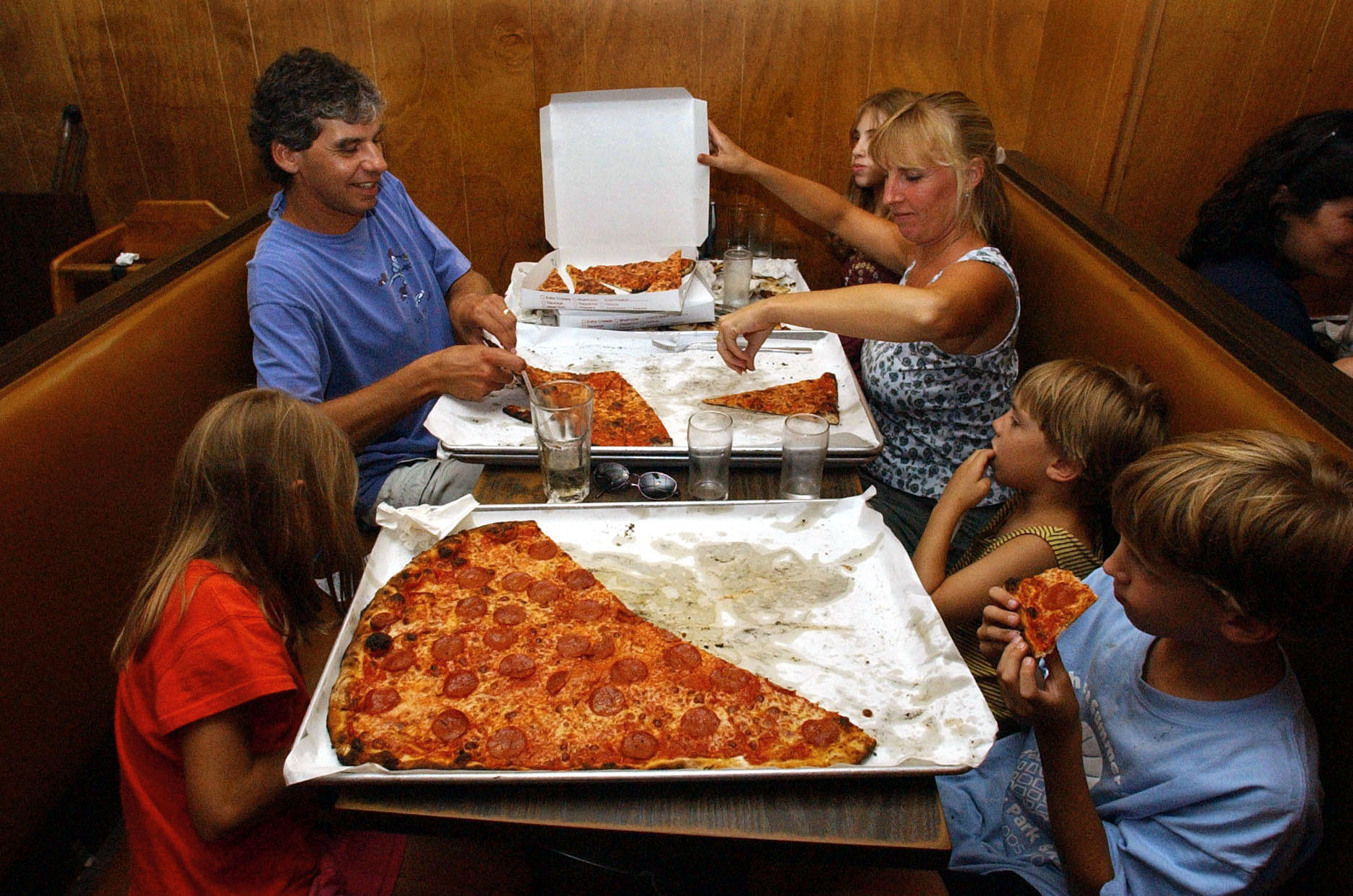 There is no other pizza for the Jasensky family, who routinely drive the two-and-and-a half hour round trip from their home in Bethlehem for Sally's Apizza on Wooster Street in New Haven. Established in 1938 just up the street from Pepe's by Sal Consiglio, a nephew of Frank Pepe, the rivalry between Pepe's and Sally's has helped create the legend of New Haven pizza. Sally's has it's own legion of faithful customers, like the Jasenskys who swear that Sally's is the best pizza in the state. (Aug. 21, 2003)