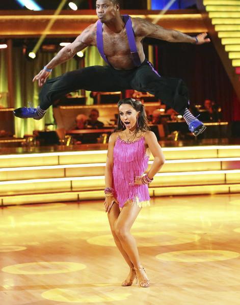 "Jacoby Jones leaps over partner Karina Smirnoff on ""Dancing with the Stars."""
