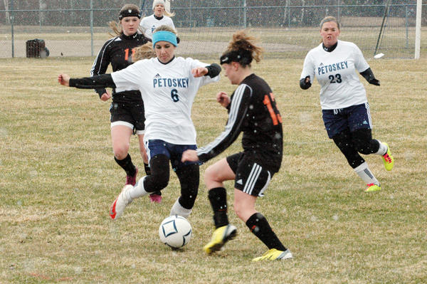 Petoskey senior Ilena Yankoviak (6) looks to work the ball away from an Elk Rapids defender during Friday's non-league match at the River Road Athletic Complex. The Northmen and Elks played to a scoreless draw.