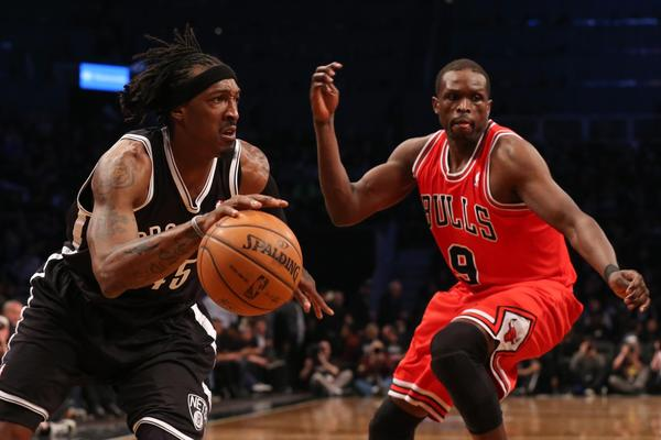 Brooklyn Nets small forward Gerald Wallace drives past Bulls small forward Luol Deng during the third quarter of Game 1 Saturday.