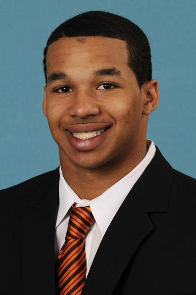 Virginia Tech running back Michael Holmes was arrested early Sunday morning in Blacksburg and charged with one count of malicious wounding and two counts of simple assault.