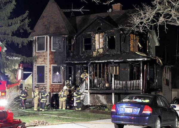 Firefighters work at the scene of a fire in the 21000 block of West Glendale Road in Lake Zurich on Sunday night. Two people were hospitalized and a firefighter sustained a minor injury.