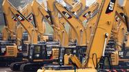 Heavy-equipment maker Caterpillar Inc. reported a 45% drop in first-quarter profit and cut its full-year outlook amid a slowdown in its mining business.
