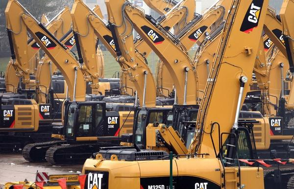 Caterpillar Inc. cut its full-year sales and profit forecast amid a slowdown in orders for mining equipment.