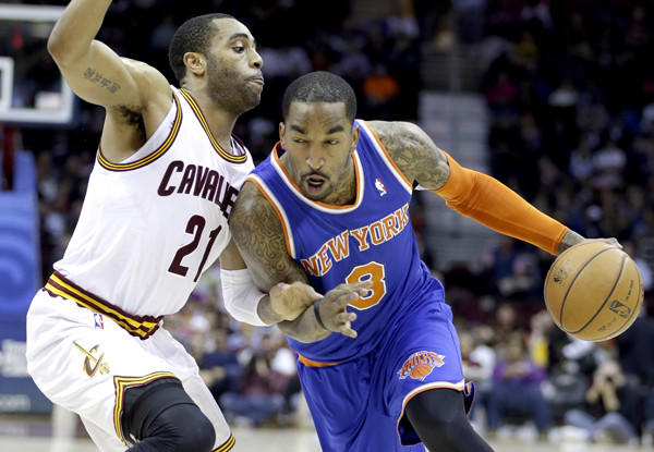 Knicks guard J.R. Smith drives against Cavaliers guard Wayne Ellington during a game in Cleveland.