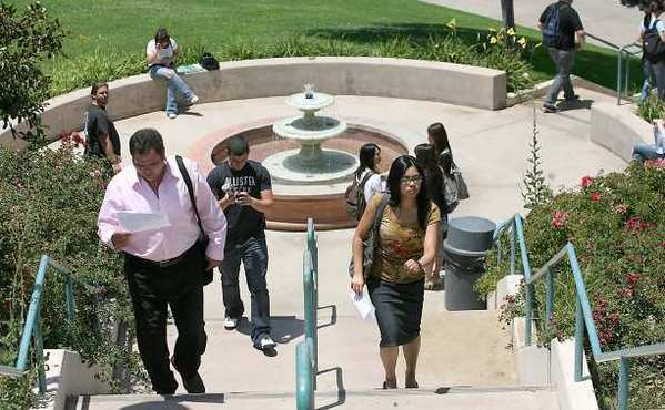Students walk to class at Glendale Community College, which will be smoke-free.
