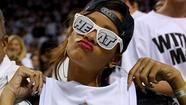 Rihanna shows love for the Miami Heat