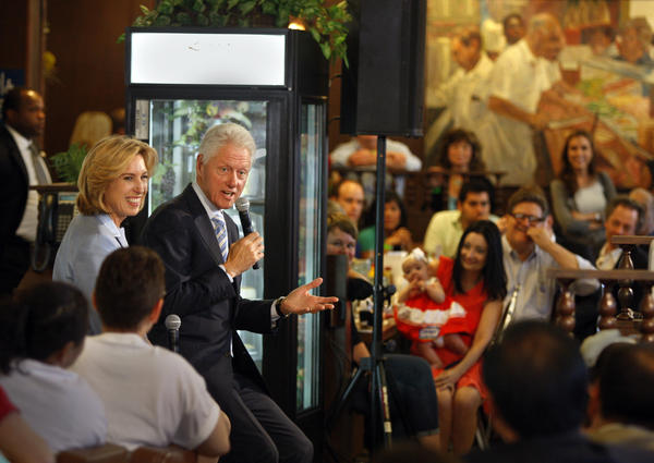 Former President Bill Clinton, center, appears in support of Los Angeles mayoral candidate Wendy Greuel, left, at Langer's Delicatessen on Saturday.