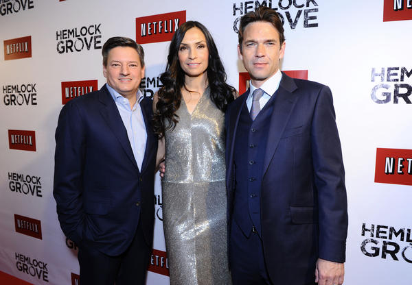 "Netflix Chief Content Officer Ted Sarandos, left, was named to Time's list of the 100 most influential people in the world. He appears with actress Famke Janssen, center, and actor Dougray Scott, at the North American premiere of the latest Netflix original series, ""Hemlock Grove."""