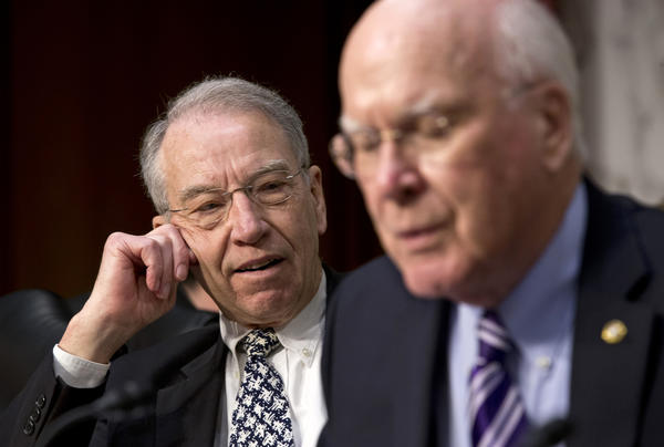 Sen. Charles Grassley (R-Iowa), left, pauses after a brief but heated response to remarks by Sen. Charles Schumer (D-N.Y.) during a Judiciary Committee hearing on immigration reform.