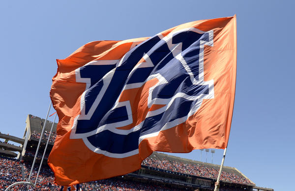 Auburn cheerleaders wave the flag following a touchdown during their A-Day spring game at Jordan-Hare Stadium.