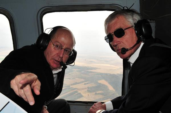Israeli Minister of Defense Moshe Yaalon, left, takes Defense Secretary Chuck Hagel on a helicopter tour of the Golan Heights.