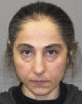 This June 2012 booking photo released by the Natick, Mass., police shows Zubeidat Tsarnaev, mother of Tamerlan and Dzhokhar Tsarnaev, the two men who allegedly set off bombs near the Boston Marathon finish line. Zubeidat Tsarnaev was arrested in June 2012 on a shoplifting charge at a Lord & Taylor store in Natick.