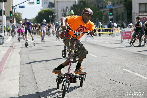A CicLAvia participant rides a Trikke vehicle down Main Street in downtown L.A. during CicLAvia on Sunday.