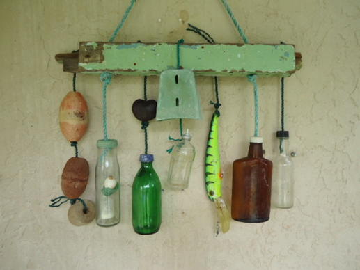 "Clare Frost of Dania makes these wall hangings from stuff found on beaches in Florida and the Bahamas. ""I like to think I am cleaning up after the folks that throw this stuff into the ocean and making art at the same time!"" she says."