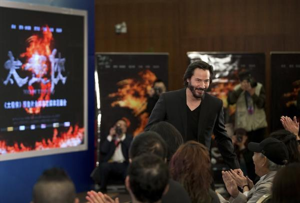 "Keanu Reeves makes an appearance in Beijing on Saturday to promote his new movie ""Man of Tai Chi"""