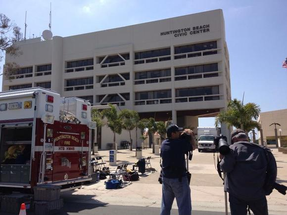 Huntington Beach City Hall is evacuated after an envelope with a suspicious substance was discovered.
