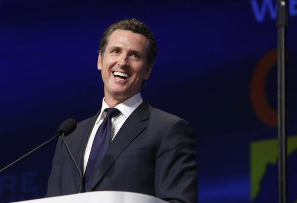 Lt. Gov. Gavin Newsom jokes about his actions as acting governor during a speech at the state Democratic Party Convention in Sacramento.