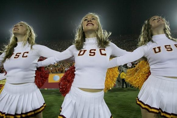 The USC Trojans Song Girls cheerleader team performs in the game with the Virginia Cavaliers at Los Angeles Memorial Coliseum on September 11, 2010 in Los Angeles, California. USC won 17-14
