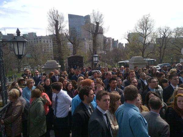 Massachusetts state employees gather on the steps of the State House in Boston to take part in a moment of silence for the victims of the Boston Marathon bombings.