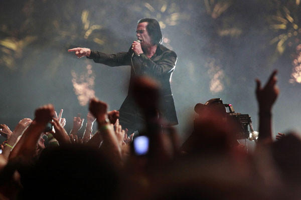 Nick Cave walks into the crowd on the third and final day of the Coachella Valley Music and Arts Festival.