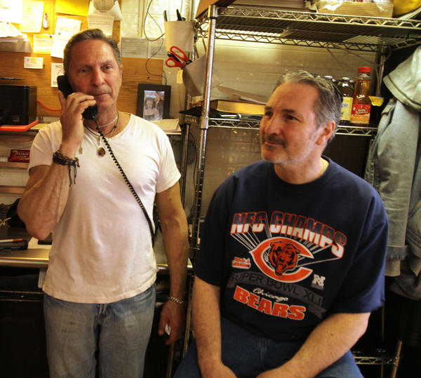 Brothers Ken (white t-shirt), and Daniel Hechtman at their restaurant, Ken's Diner in Skokie. They witnessed an accident Sunday night on the Edens Expressway and helped the people in the accident to safety when one of the vehicles burst into flame.