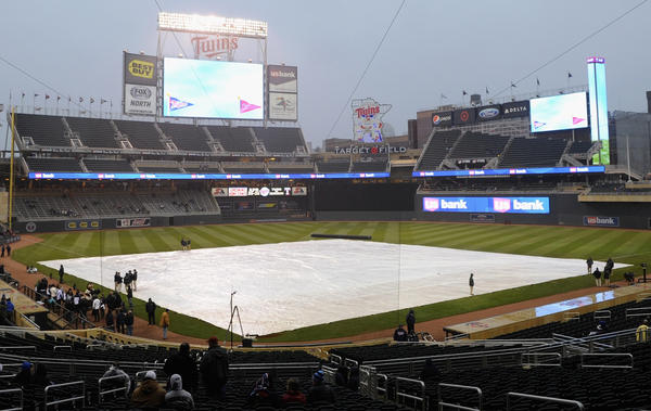 MINNEAPOLIS, MN - APRIL 17: The tarp is shown on the field before the game between the Minnesota Twins and the Los Angeles Angels of Anaheim on April 17, 2013 at Target Field in Minneapolis, Minnesota. The game was postponed to a later date due to cold and rain. (Photo by Hannah Foslien/Getty Images) ORG XMIT: 163493170