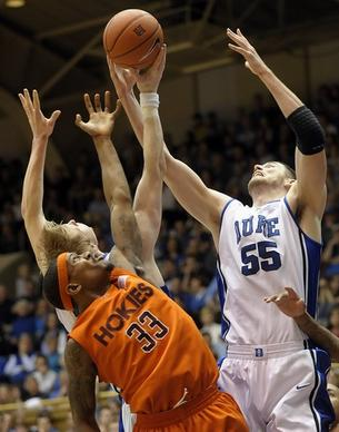 Duke's Brian Zoubek (55) and Kyle Singler, back, reach for a rebound over Virginia Tech's J.T. Thompson (33) during the first half of an NCAA college basketball game in Durham, N.C., Sunday, Feb. 21, 2010. Duke won 67-55