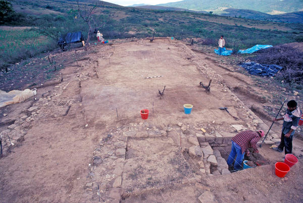 A temple excavated at the El Palenque site in Oaxaca, Mexico. At right, workers expose a staircase that may have led to private areas accessible only to priests.