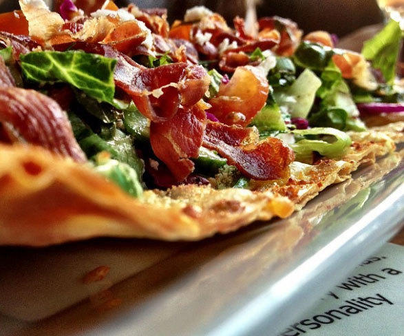 The Lady Falco flatbread with salad on top from Bin No. 73 in Venice.