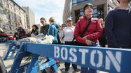 NEW BEDFORD, Mass. -- As the probe into the Boston Marathon bombings continued, investigators on Monday removed items from an apartment here where authorities had arrested two foreign nationals on immigration violations.