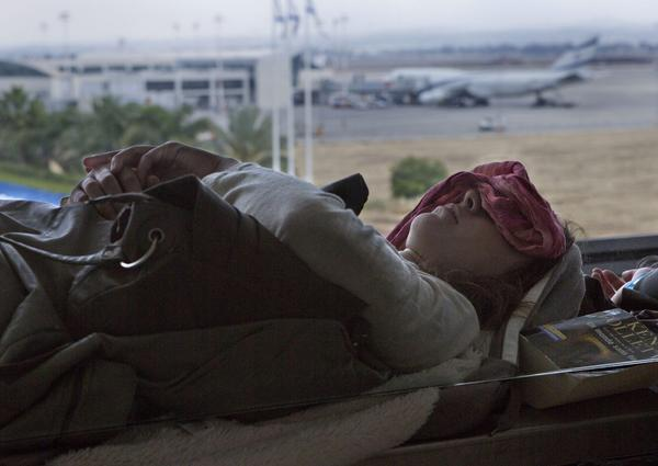 A passenger sleeps in a departure lounge at Ben Gurion International Airport outside Tel Aviv. Flights were temporarily grounded during a strike.