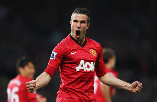 Robin van Persie of Manchester United celebrates scoring the opening goal during the Barclays Premier League match between Manchester United and Aston Villa at Old Trafford on Monday.